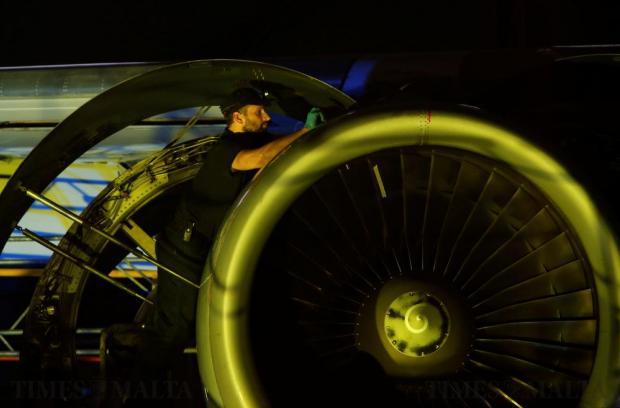 An aircraft technician carries out maintenance on an aircraft engine in a Lufthansa Technik hangar at Hal-Farrug on November 23. Photo: Darrin Zammit Lupi