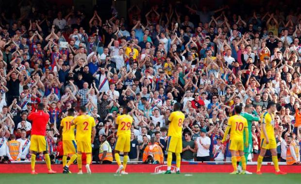 Crystal Palace players and fans celebrate after the match.