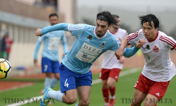 Sliema Wanderers Matias Muchardi (left), tries to make his way past Lija Athletic Kei Hirose during their BOV Premier League match at the Centenary Football Stadium in Ta'Qali on February 3. Photo: Matthew Mirabelli