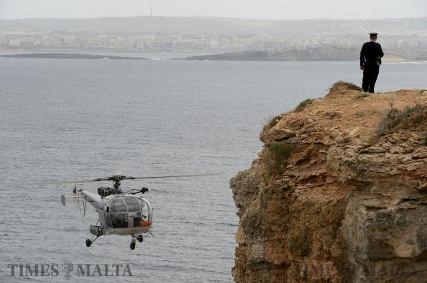 An AFM helicopter takes part in a rescue operation together with rescuers from the Civil Protection Department and the Police Force at l-Aħrax tal-Mellieħa on April 17. Photo: Matthew Mirabelli