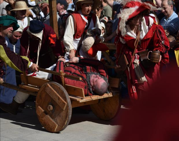 A reenactor faints and is escorted on a cart on a hot day during a medieval fight at the Medieval Mdina Festival on May 05. Photo: Mark Zammit Cordina