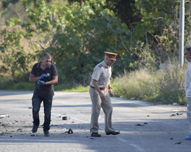 Investigators at the crime scene. Photo: Mark Zammit Cordina