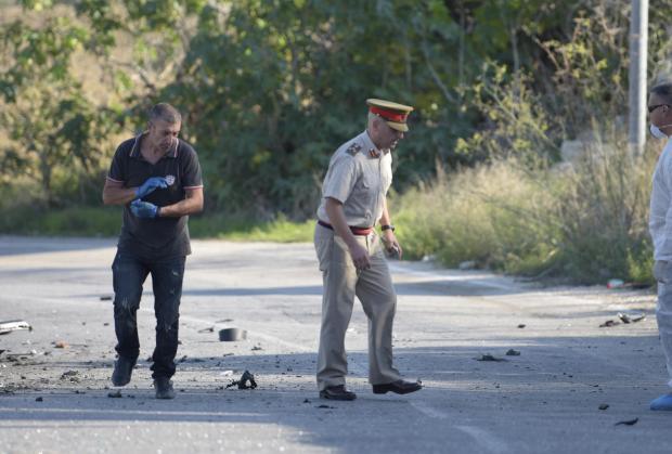Investigators comb the crime scene on October 16. Photo: Mark Zammit Cordina