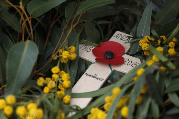 A remembrance cross is seen on the cenotaph after a service to mark the 100th anniversary of ANZAC (Australian and New Zealand Army Corps) landings at Galllipoli, at the Pieta Military Cemetery in Pieta on April 25. The Gallipoli campaign has resonated through generations, which have mourned the thousands of soldiers from the ANZAC cut down by machinegun and artillery fire as they struggled ashore on a narrow beach. The fighting would eventually claim more than 130,000 lives, 87,000 of them on the side of the Ottoman Turks, who were allied with imperial Germany in World War One. Photo: Darrin Zammit Lupi
