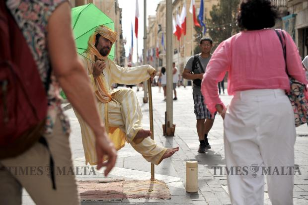 A man appears to float in Republic Street Valletta on September 5. Photo: Chris Sant Fournier