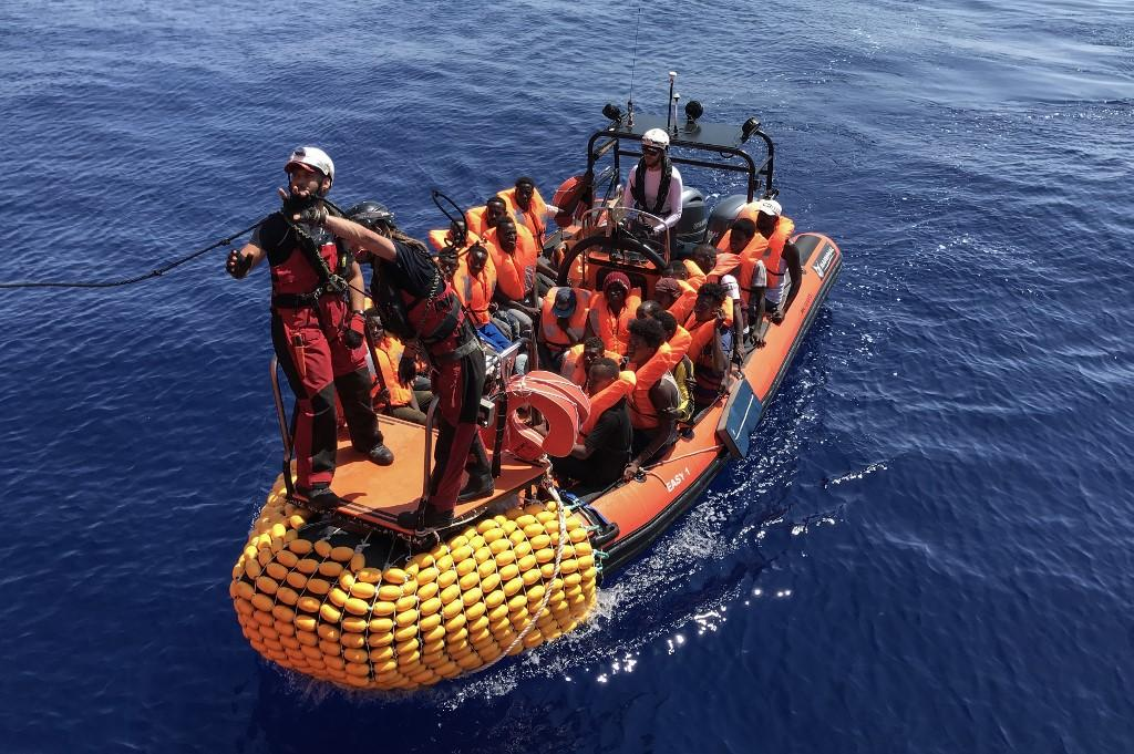Migrants are transported to the Ocean Viking after a rescue on August 12. Photo: AFP