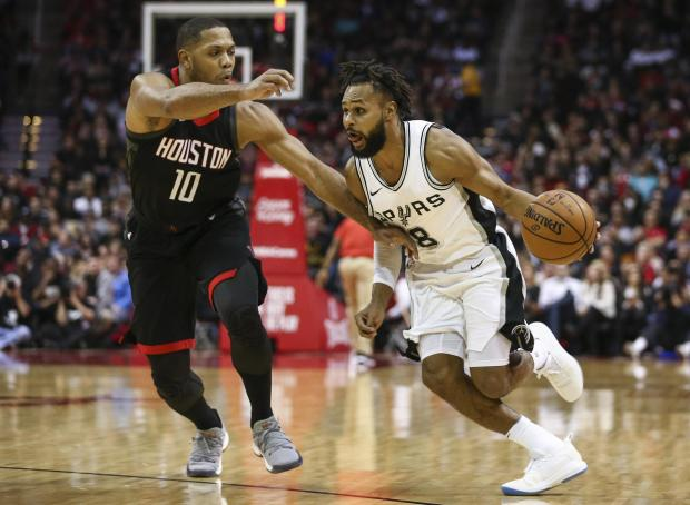 San Antonio Spurs guard Patty Mills (8) dribbles the ball as Houston Rockets guard Eric Gordon (10) defends during the third quarter at Toyota Center. Photo: Troy Taormina-USA TODAY Sports.