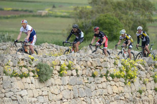 Cyclists begin the climb up San Martin Hill in St Paul's Bay during the second stage of the Tour of Malta on March 27. Photo: Matthew Mirabelli