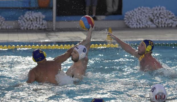 St Julian's players Aurelien Cousin and Paul Fava stop Jordan Camilleri of Neptunes during the final match of the waterpolo league at Tal-Qroqq National Pool on August 29. Photo: Mark Zammit Cordina