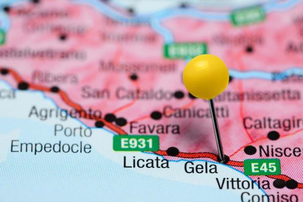 The landing point will be in Gela, Sicily.