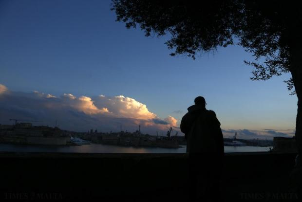 People walk along St Barbara Bastion overlooking Grand Harbour at dusk on October 27. Photo: Darrin Zammit Lupi
