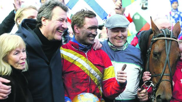 Bjorn Goop (centre) celebrates his victory with Readly Express at the Prix D'Amerique.