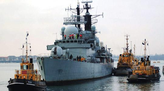 Royal Navy handout photo HMS Nottimgham being escorted into Portsmouth harbour. Photo: Andrew Linnett/PA