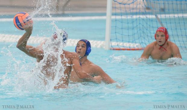 Italy's Eduardo Campopiano takes a shot at goal during their U-20 Comen Cup waterpolo match against Serbia at the National Pool in Tal'Qroqq on August 16. Photo: Matthew Mirabelli