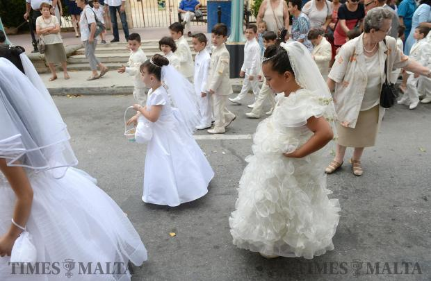 Children who just received their First Holy Communion take part in the annual Corpus Christi procession in Rabat on June 18. Photo: Matthew Mirabelli