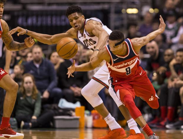 Milwaukee Bucks forward Giannis Antetokounmpo (34) and Washington Wizards guard Tim Frazier (8) chase a loose ball during the third quarter at BMO Harris Bradley Center. Photo Credit: Jeff Hanisch-USA TODAY Sports