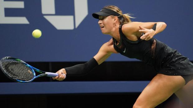Maria Sharapova of Russia hits to Sofia Kenin of the USA.