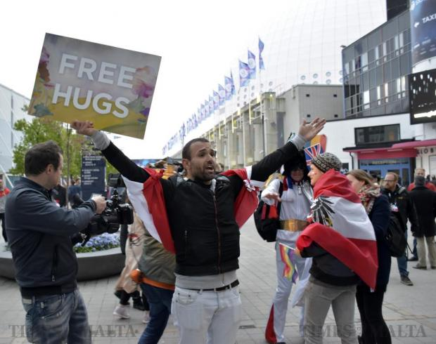 A man offers free hugs to fans before they enter the Ericsson Globe for the 2016 Eurovision Song Contest in Stockholm, Sweden, on May 14. Photo: Mark Zammit Cordina