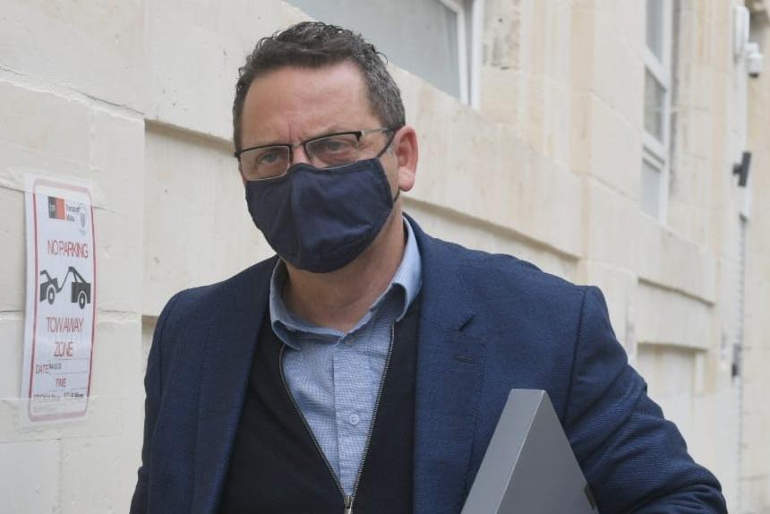 Malcolm Scerri enters the Financial Crimes Investigation Department last Saturday. Photo: Matthew Mirabelli