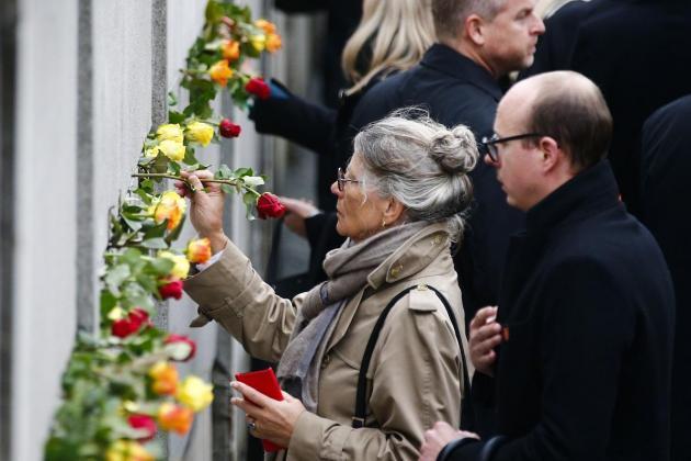 On Berlin Wall anniversary, Merkel urges Europe to defend freedom