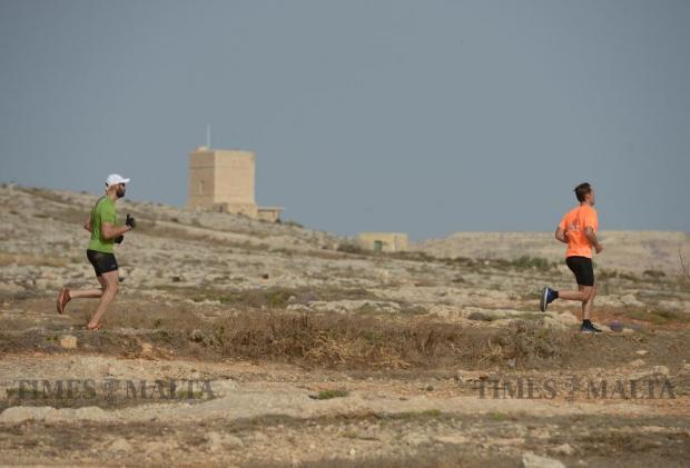 Two athletes take part in The Grid obstacle course race in Pembroke on May 29. The race, the first of its kind in Malta, covered 15km and included over 30 obstacles. Photo: Matthew Mirabelli