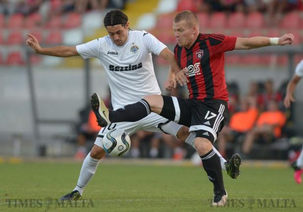 Hibernians' Juan Manuel Varea (left) tries to win the ball from Spartak Trnava's Peter Čögley, during their second leg Europa League match at the Hibernians Stadium in Corradino on July 7. Spartak Trnava's qualified with a 6-0 aggregate. Photo: Matthew Mirabelli