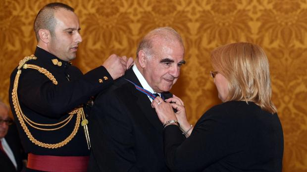 Dr Vella being made a companion of the National Order of Merit in 2017 by President Coleiro Preca. Photo: DOI/Clifton Fenech