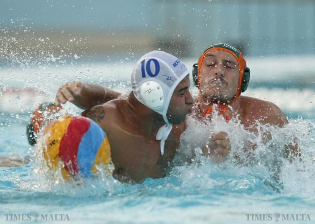 Marsaxlokk's Rainer Scerri (left) defends possession of the ball against Marsascala's Jean Claude Cutajar during the First Division Knock-Out waterpolo final at the National Pool in Tal-Qroqq on August 26. Photo: Darrin Zammit Lupi