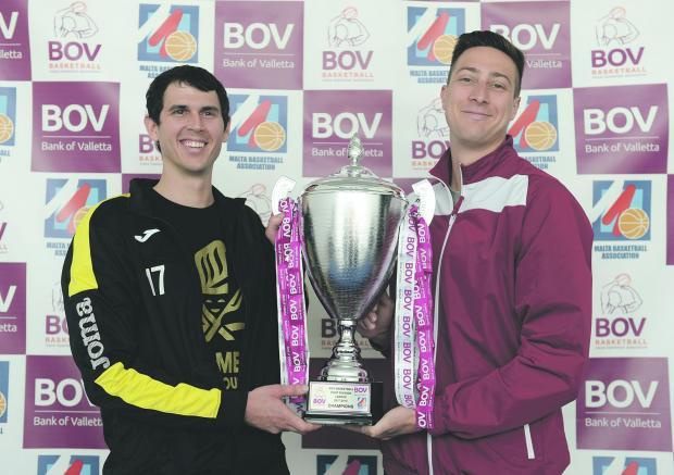 Hibs player Chad Patus (left) and JonFeiler, of Gżira Athleta, hold the trophy. Photo: Matthew Mirabelli