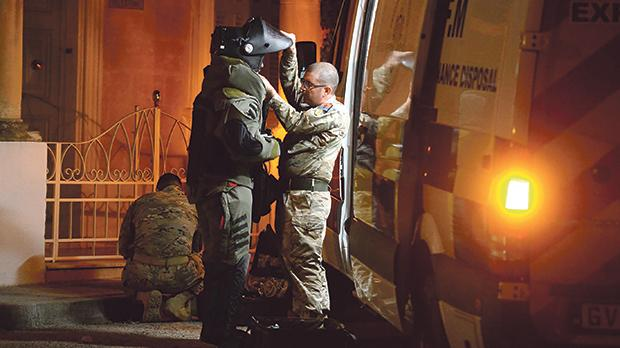 The bomb disposal unit prepares to examine the package on Friday night. Photo: Matthew Mirabelli