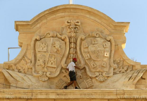 A worker carries out restoration works on the facade of the Auberge de Castille, built between 1571 and 1574 and now used as the Office of the Prime Minister, in Valletta on September 28. Photo: Darrin Zammit Lupi