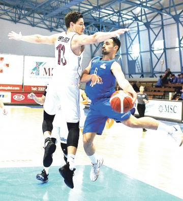 Starlites player Robert Bonnici passes the ball past Vince Pace, of Gżira Athleta. Photo: Wally Galea