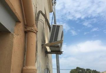 'Talk to the police,' concerned citizen is told after reporting dangling AC unit