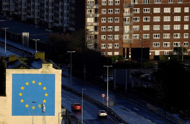 A large mural depicting the EU flag being chipped away and attributed to the British artist Banksy is seen at the Port of Dover in south east Britain, December 7, 2018. Photo: Reuters