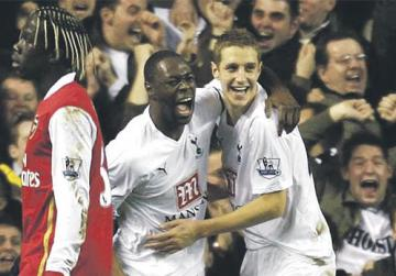 Ledley King (centre) celebrates with Spurs team-mate Michael Dawson during the League Cup semi-final against Arsenal at White Hart Lane.