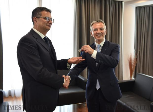 Former Nationalist Party leader Simon Busuttil hands over the headquarters keys to newly appointed Nationalist party leader Adrian Delia in Pieta on September 18. Photo: Mark Zammit Cordina