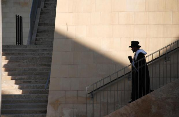 Like a ghost sent by the Capital's founder - Grandmaster Jean de Vallette – to examine modern additions to his city, a robed man walks down the steps behind the new parliament building in Valletta on July 6. Photo: Mark Zammit Cordina