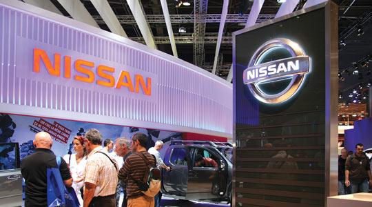 Nissan saw third quarter profits rise despite the pressures of softer domestic demand and a strong yen.