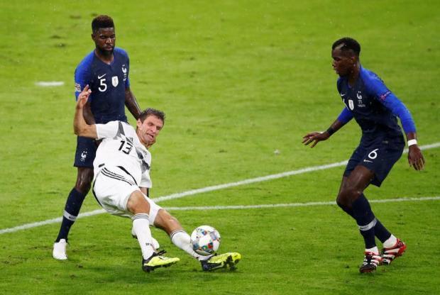 Samuel Umtiti (left) in action for France.