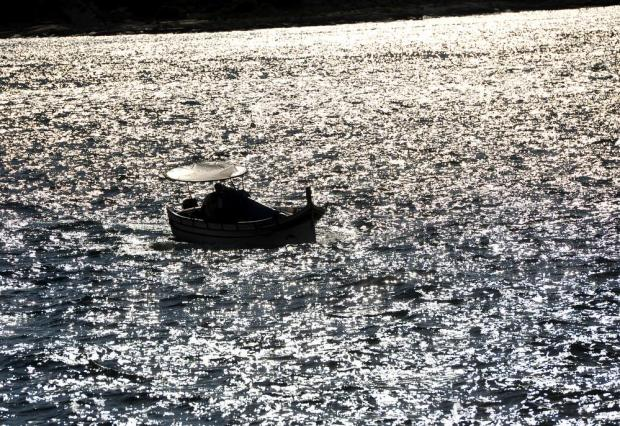 A fishing boat leaves Marsamxett Harbour on July 18. Photo: Chris Sant Fournier