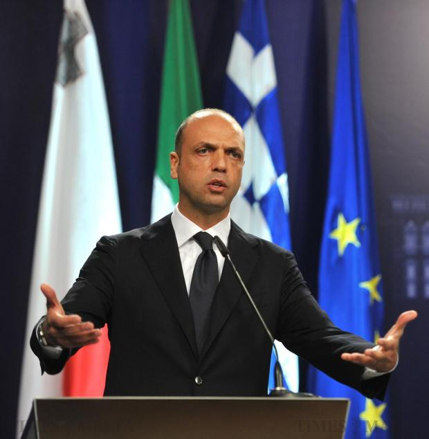"""Italian Minister for Home Affairs Angelino Alfano speaks during a news conference held following a funeral for 24 migrant victims on April 23. """"The scenes today were a punch in the stomach for those who are indifferent,"""" he said. Photo: Jason Borg"""
