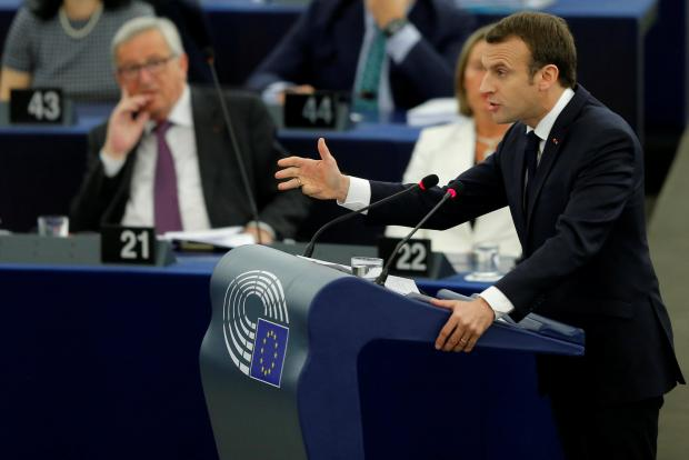 Macron speaks to MEPs in Strasbourg, as Jean-Claude Juncker looks on. Photo: Reuters