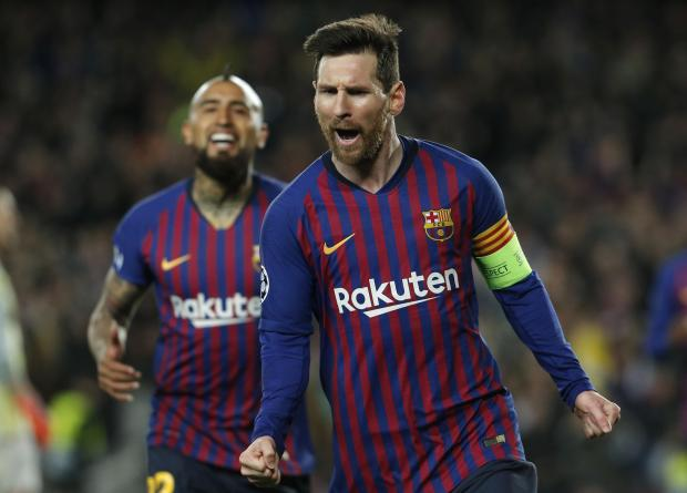 Barcelona's Lionel Messi celebrates one of his goals in their Champions League second leg tie against Lyon.