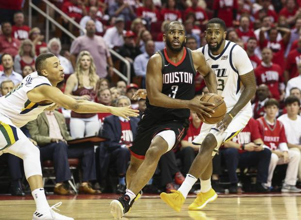 Houston Rockets guard Chris Paul (3) drives with the ball as Utah Jazz guard Dante Exum (11) and forward Royce O'Neale (23) defend during the fourth quarter in game two of the second round of the 2018 NBA Playoffs at Toyota Center. Photo Credit: Troy Taormina-USA TODAY Sports