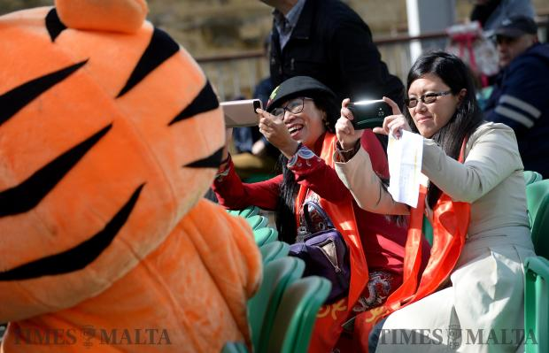 Two ladies take photos of a tiger costume at the Pjazza Teatru Rjal in Valletta on February 13. Photo: Matthew Mirabelli