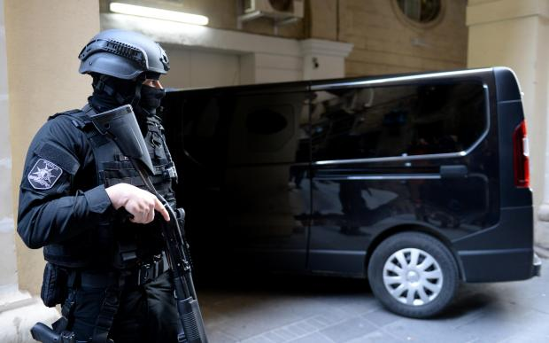 Armed guard outside court last December as the suspects were driven in.