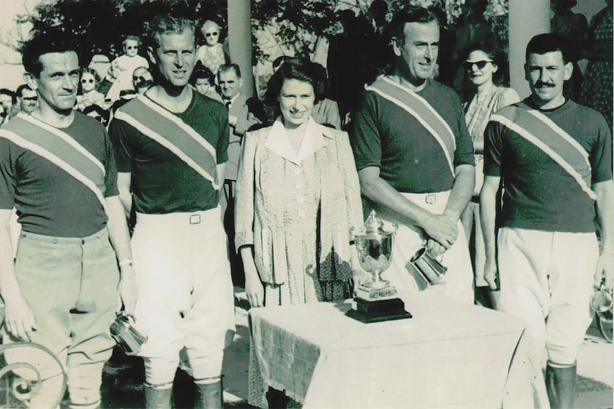 Queen Elizabeth and Prince Philip (second from left) during a visit to the polo club in the 1950s.