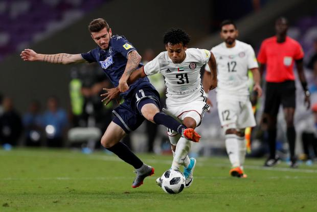 Auckland City's Fabrizio Tavano in action with Al Jazira's Romarinho.