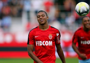 Kylian Mbappe closing in on a move to PSG.