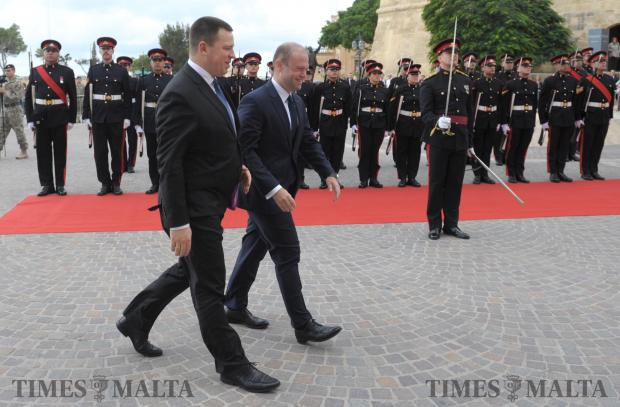 Estonian Prime Minister Jüri Ratas and Joseph Muscat make their way to the guard of honor outside Castille on November 13. Photo: Matthew Mirabelli